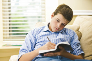 LDS Young Man Studying the Scriptures
